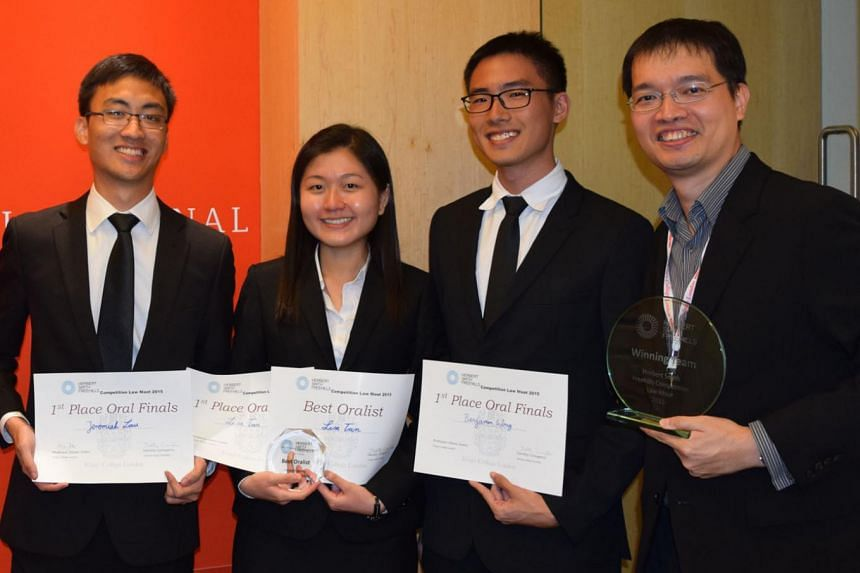 NUS law students (from left) Jeremiah Lau, Lisa Tan and Benjamin Wong with their coach, Associate Professor Burton Ong. Ms Tan also won the Best Oralist award, while Mr Lau and Mr Wong finished as joint runners-up.
