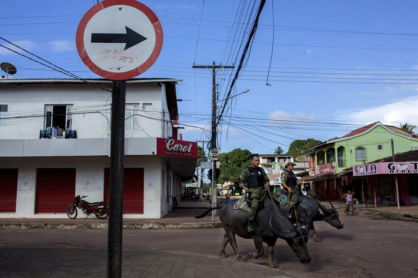 Military police on patrol atop water buffaloes, a longstanding practice on the Brazilian island of Marajo. The animals thrive in the equatorial heat and are adept at navigating the island's swamplands, and officers say their presence helps to lower