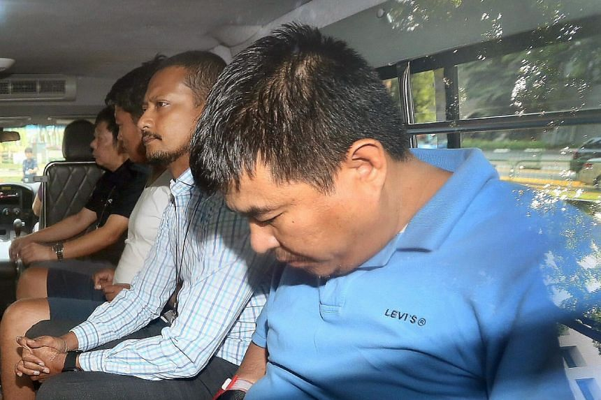 (From left) Myanmar nationals Phyo Min Naing and Yae Wynnt Oaung (wearing spectacles), and Singapore PR Zaw Min Hlaing were yesterday charged with abetment by conspiracy to murder Mr Aye Maung Maung Thet, a Singapore PR. A fourth man who was involved