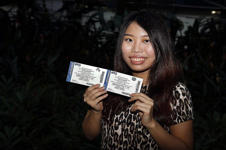 Straits Times reader Pearlyn Loh with the tickets to Taylor Swift's concert in London she won in a contest to celebrate the newspaper's 170th birthday.