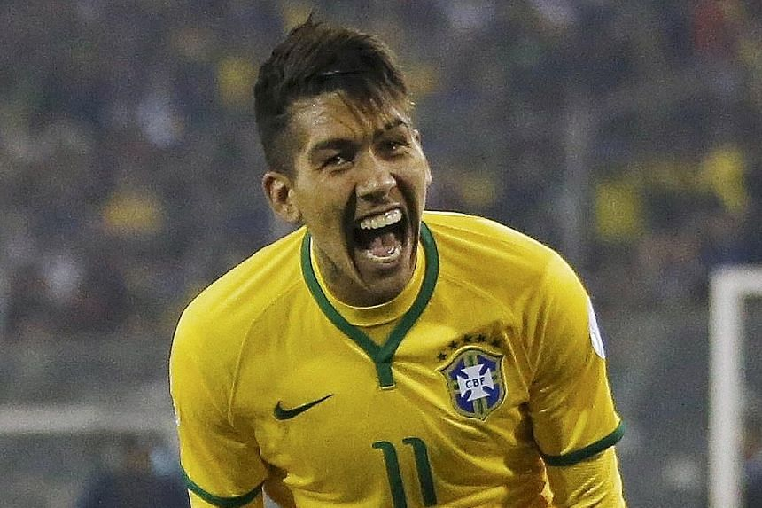 Roberto Firmino is elated after scoring in Brazil's 2-1 Copa America group-stage win over Venezuela.