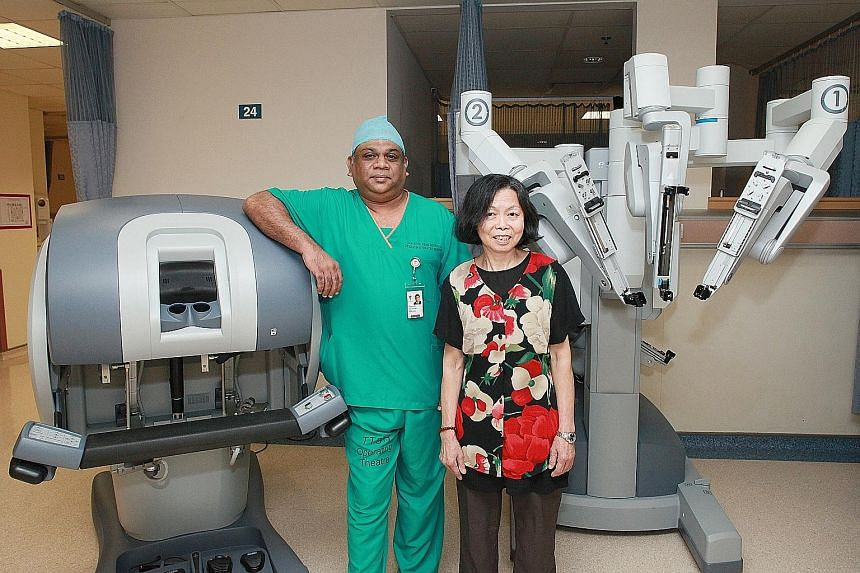 Dr Aneez Ahmed successfully operated on Madam Woo Quai Kuen using robot arms. The 68-year-old cook was discharged three days after a lump in her lung was removed.