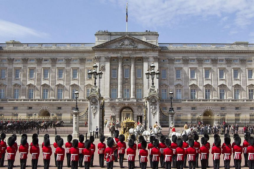 Guardsmen forming a guard of honour as Queen Elizabeth II left Buckingham Palace in a coach for the Palace of Westminster for the State Opening of Parliament last month.