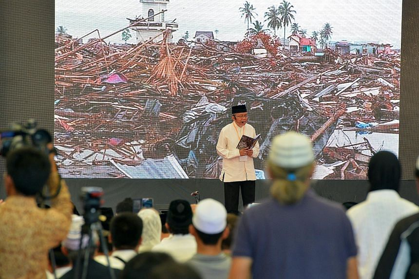 A man from Aceh, recalls the flashback of the Aceh Tsunami at the Aceh Tsunami Commemoration Event in Banda Aceh, Indonesia on December 26, 2014.