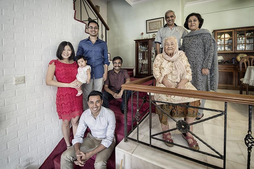 Mr Adam Maniam (standing, left), with wife Yap Cuixian and their daughter Amelia Ri-En, his elder brother Aaron (seated, top) and younger brother Ashraf, together with his father Sydney (right), mother Bibe Zoolaha and maternal great-grandmother Chan