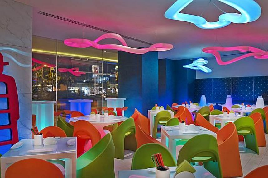The vibrant interior of A.T.O.S, Royal Plaza on Scotts, which serves tapas with an Asian touch.