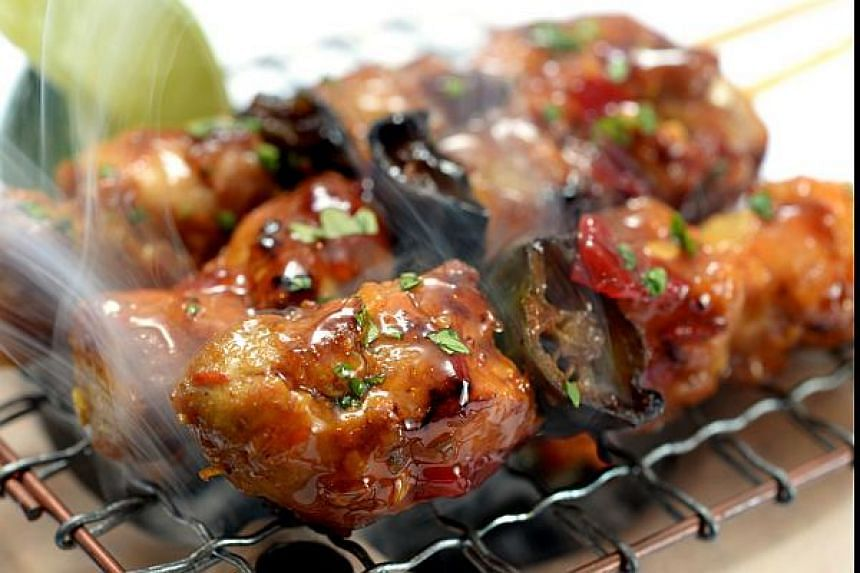 Chicken Skewers marinated in Indonesian spices have a tangy chilli kick.