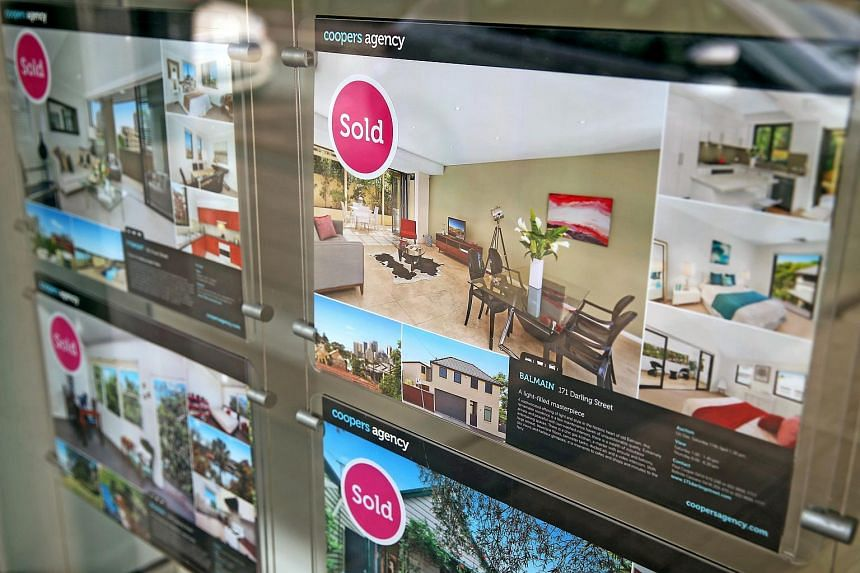 Property listings marked as sold are displayed in the window of Coopers Agency property agents in the suburb of Balmain in Sydney, Australia, on Thursday, June 18, 2015.