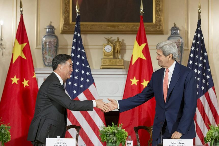 US Secretary of State John Kerry (right) shakes hands with Vice Premier of China Wang Yang after closing remarks of the 2015 US-China Strategic and Economic Dialogue.