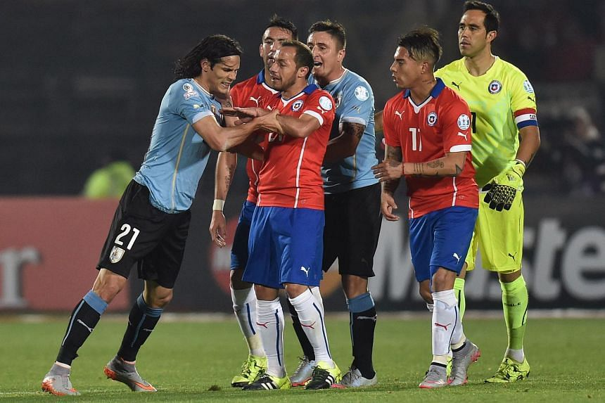 Uruguay's forward Edinson Cavani (left) argues with Chile's midfielder Marcelo Diaz (second left) during their 2015 Copa America football championship quarterfinal match against Uruguay.