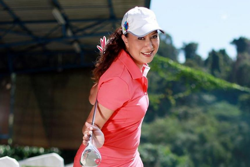 Ms Claressa Monteiro, a senior presenter at Kiss 92, is a regular golfer who is trying to perfect her swing. - ST PHOTO: DANIEL YEO
