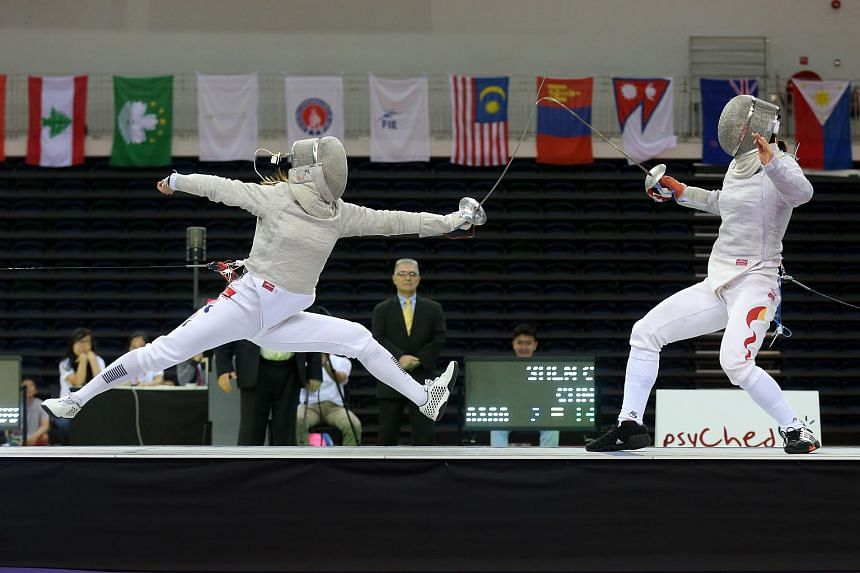 Kim Ji Yeon (left) of South Korea attacking against Shen Chen (right) of China at the Asian Fencing Championship individual sabre semi-finals on Thursday, June 25, 2015. Kim lost to Shen 14-15 in a surprise defeat.