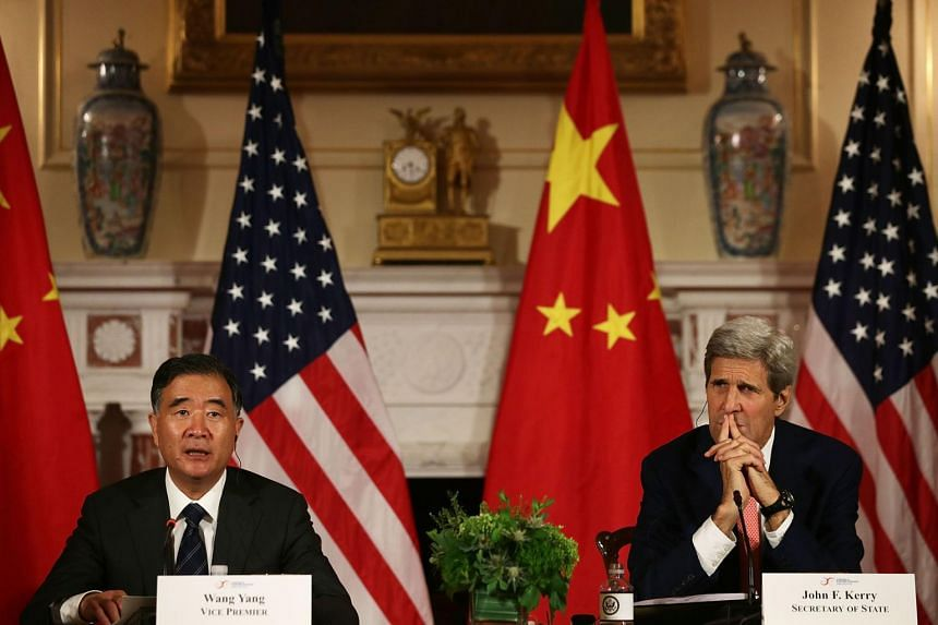 U.S. Secretary of State John Kerry (Right) and Chinese Vice Premier Wang Yang (Left) participate in closing statements June 24, 2015 at the Department of State in Washington, DC.