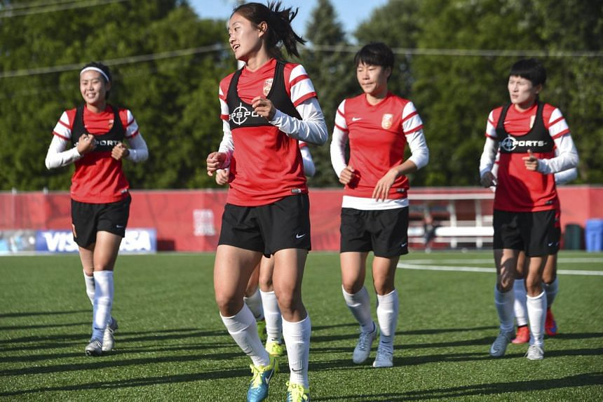 Members of China's national team take part in a training session in Ottawa on June 24. China is one of the eight teams that are through to the Women's World Cup quarter-finals.