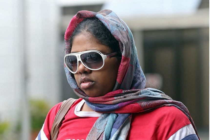 Suganthi Jayaraman, who is charged with maid abuse, is photographed leaving the State Courts on May 22, 2015.