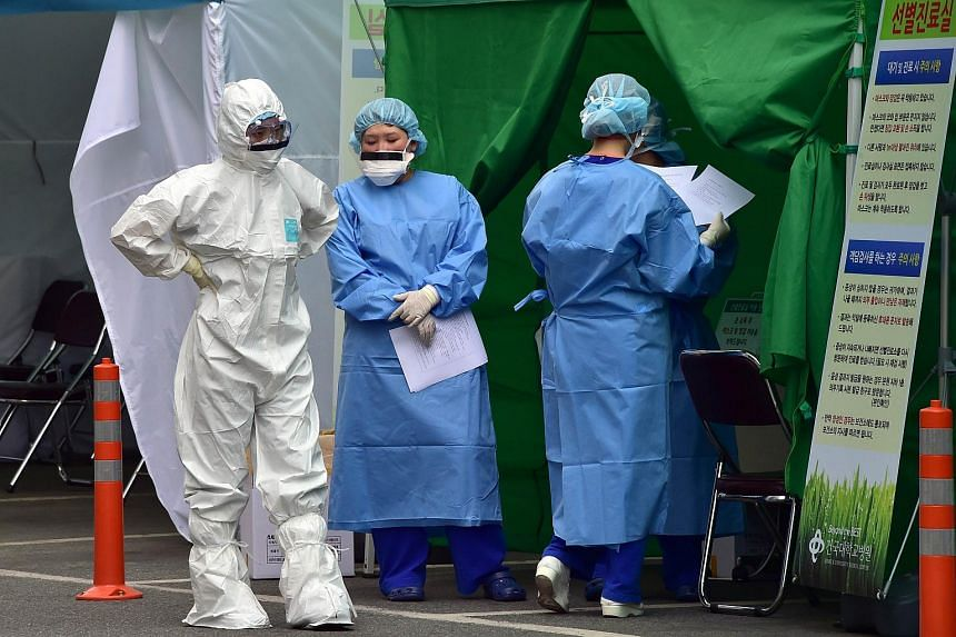 South Korean medical workers wear protective gear at a separated clinic centre for Mers at Konkuk University Hospital in Seoul on June 24, 2015.
