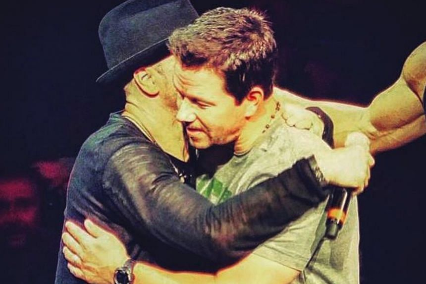 Actor Mark Wahlberg (right) rejoined his brother Donnie (right) and his former New Kids On The Block bandmates onstage during their show at Madison Square Garden on Monday. Donnie, 45, later posted a picture of them hugging on Facebook, writing, ''Ma