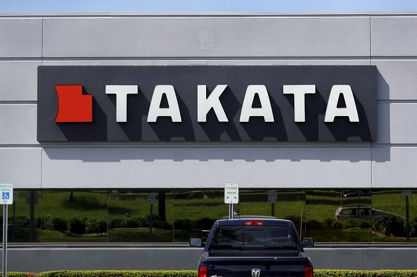 A sign with the Takata logo is seen on the building of the Takata Corporation in Auburn Hills, Michigan on May 20, 2015.