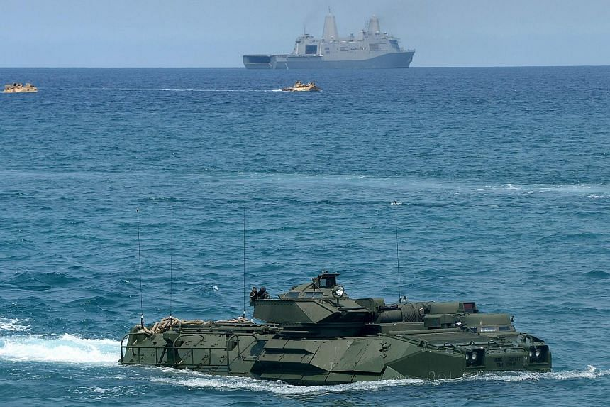 A US Marine amphibious assault vehicle (AAV) makes its way to shore during an exercise at San Antonio in Zambales province, the Philippines, on April 21, 2015. China has reacted angrily after the United States Senate passed a bill which encourages Ta