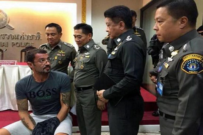 Xavier Andre Justo (left) appearing before the media after being arrested in Thailand on Monday for seeking 2.5 million Swiss francs (S$3.6 million) from PetroSaudi in exchange for not disclosing confidential company information, including alleged wr