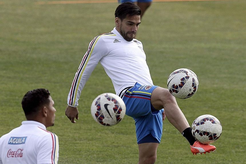 Radamel Falcao (right, in training) will hope that he can break his duck in the Copa when Colombia take on Argentina in the quarter-finals.