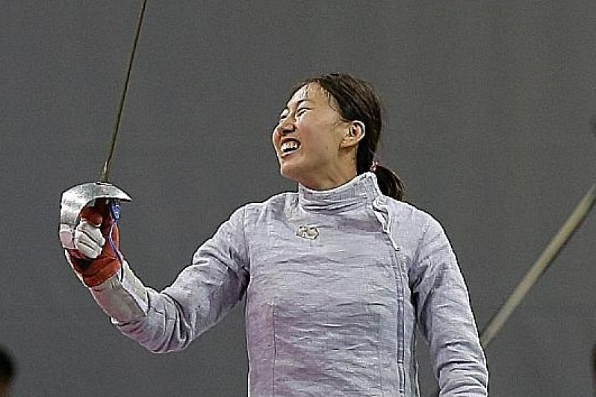 Shen Chen of China celebrating her 15-7 win over Chika Aoki in the sabre final, following two bronzes in the last two editions of the championships.