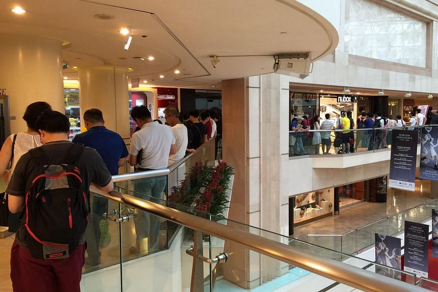 Long queues for the Apple Watch at Nubox Raffles City on Friday (June 26).
