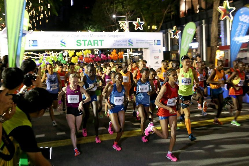 Participants at the flag-off point of the Standard Chartered Marathon Singapore (SCMS) in Orchard Road on Dec 7, 2014. Running enthusiasts can now participate by registering via social media.