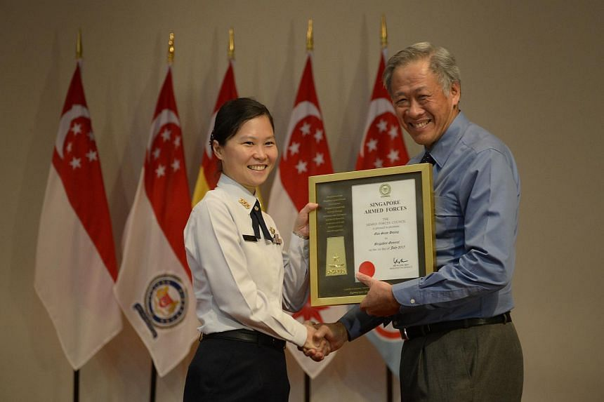 Col Gan receiving her certificate of promotion from Defence Minister Ng Eng Hen.