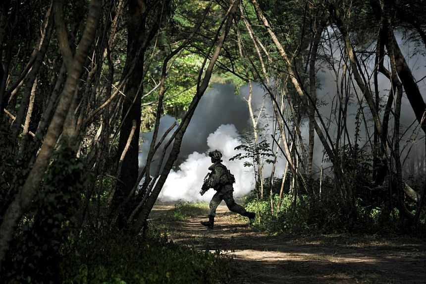 A soldier running with his weapon during the Singapore Armed Forces (SAF) Readiness Exercise held on Aug 2, 2011 at Pulau Sudong. The SAF will be conducting a range of military exercises from from 8am on June 29 to 8am on July 6.