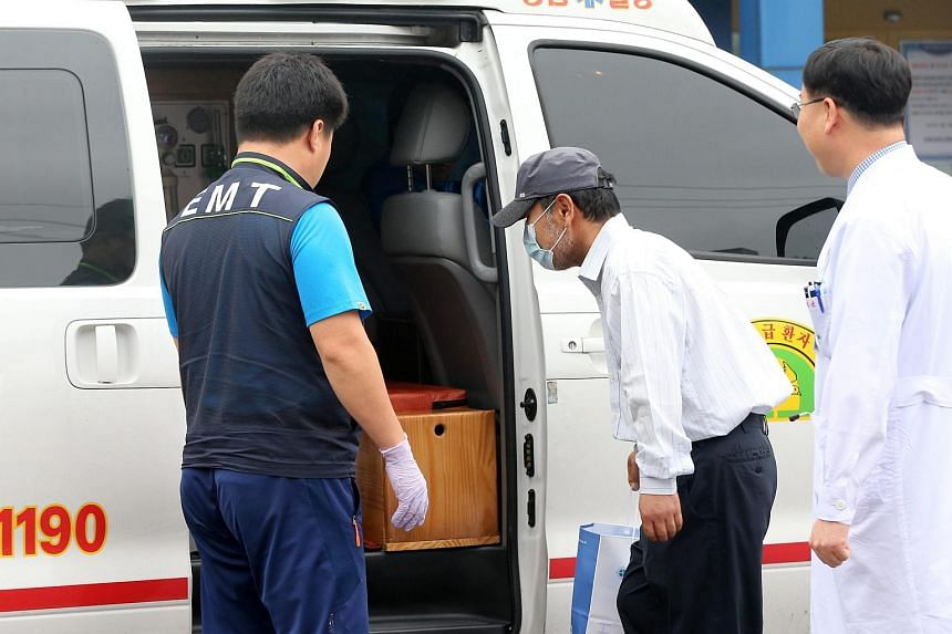A man getting into an ambulance in Daegu on June 26 to return home after recovering from Mers.