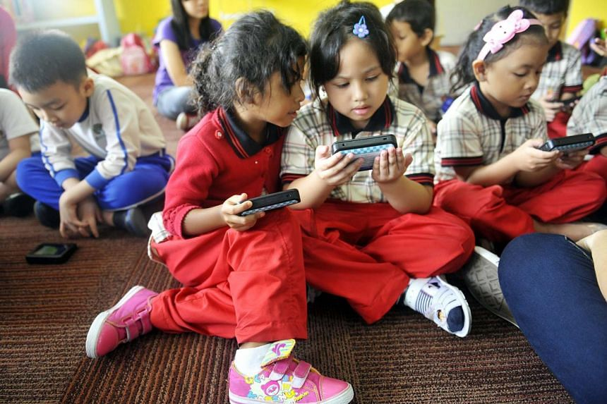There are currently no official guidelines on the length of screen time children should be exposed to in Singapore. - ST FILE PHOTO