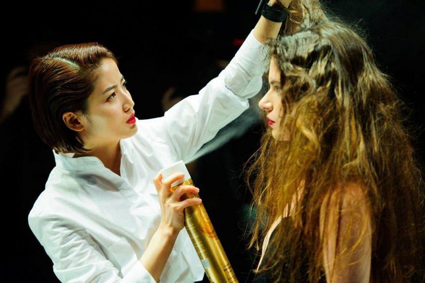 South Korean hairstylist Chahong styling a model's locks. To maintain strong and healthy hair, use a clarifying or exfoliating shampoo regularly to get rid of dead skin and residue build-up from hair products.