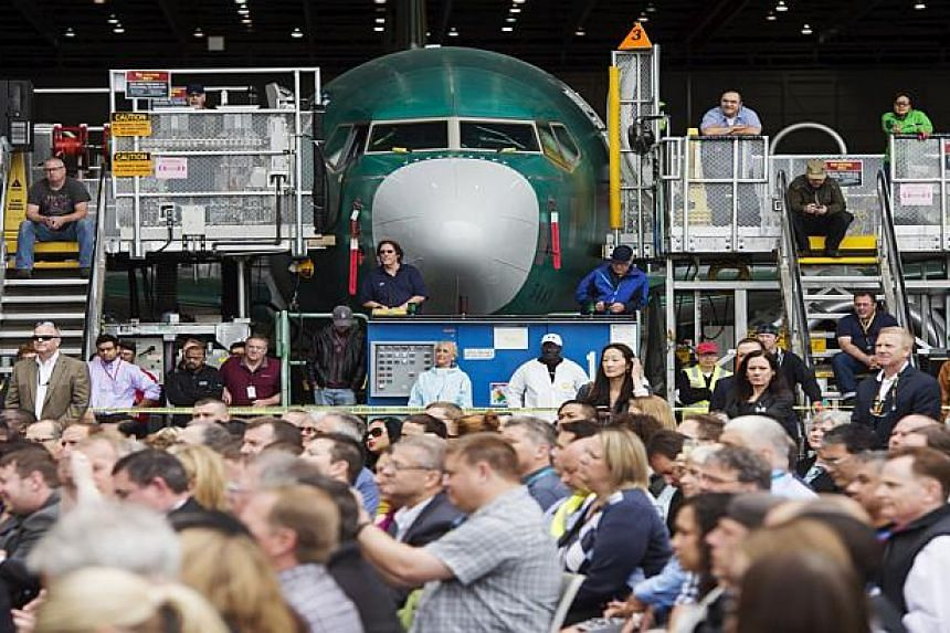 Boeing employees listen as US Secretary of State John Kerry speaks about the Trans-Pacific Partnership.