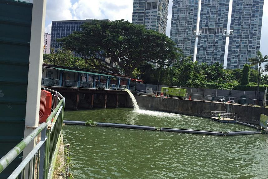 The body was lying in a blue tent at a corner of this dam-like structure of the Rochor Canal on Saturday, June 27, 2015.