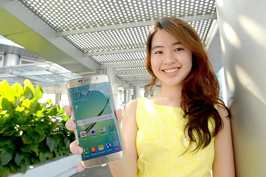 Ms Stacy Foo is one of the winners of a Samsung Galaxy S6 Edge 4G+ smartphone.