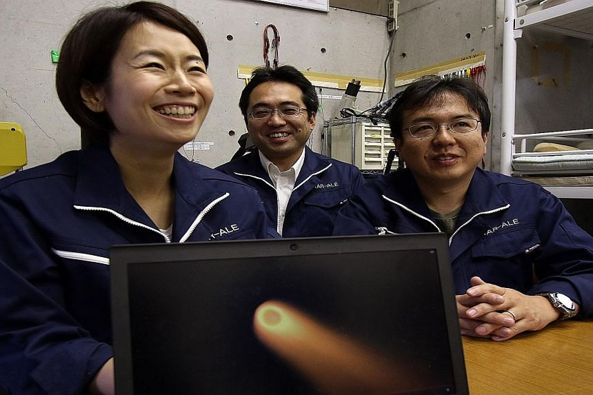 Ms Lena Okajima, CEO of space technology venture ALE, with Tokyo Metropolitan University associate professor Hironori Sahara (right) and Teikyo University lecturer Takeo Watanabe, speaking about their business to produce shooting stars in the sky.