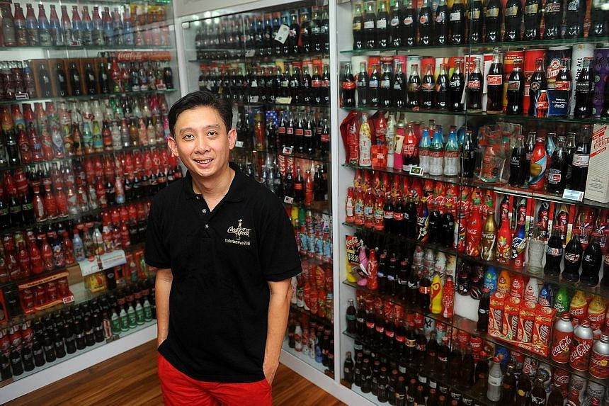 Mr Kannie Yeo and his Coca- Cola bottle and can collection.