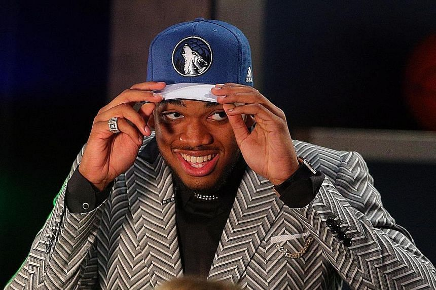 Centre Karl-Anthony Towns has the attributes that the Timberwolves seek in a bid to turn around their fortunes. They have not advanced to the play-offs since 2004.