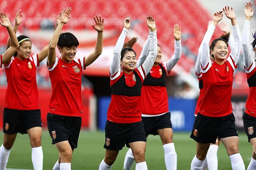 The Chinese women's football team training at Lansdowne Stadium in Ottawa, Ontario on the eve of their World Cup quarter-final against the US, a repeat of the 1999 final in California.