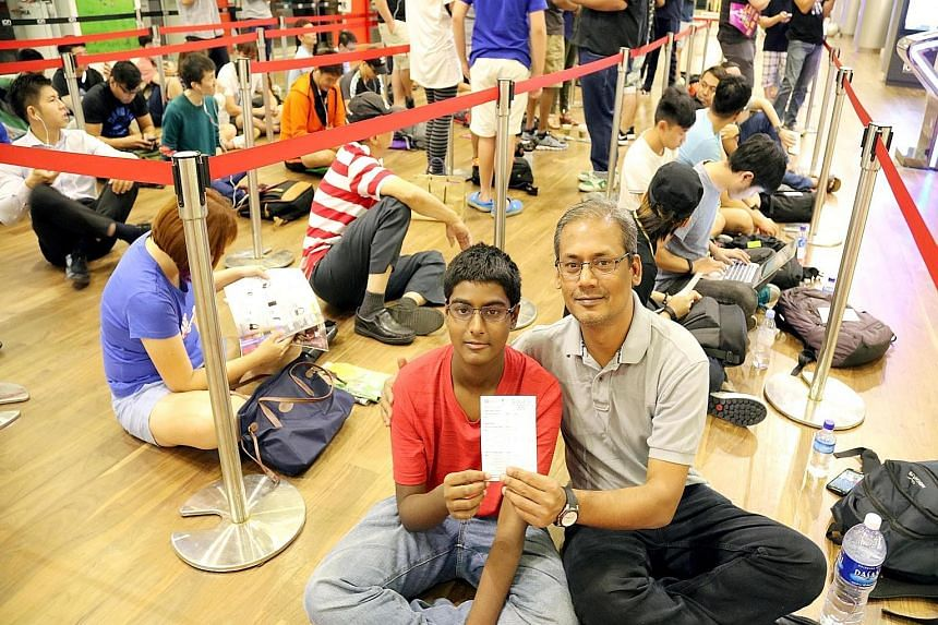 """Student Sriram Rengamannar and his father, Mr Renga Mannar, were first in line to buy the Apple Watch yesterday after a 12-hour wait at Ion Orchard's EpiCentre store. """"I was too excited to sleep,"""" said the 13-year-old."""