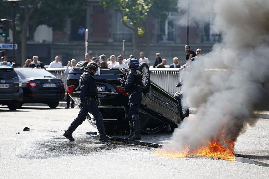 The busy Porte Maillot junction in Paris was one of several places hit by violence as taxi drivers clashed with Uber drivers on Thursday.