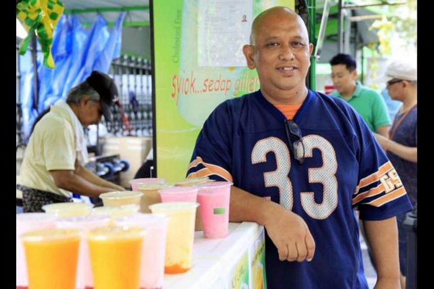 Owner of Botakmania Mohammed Yassin Harin with smoothies that his stall sells.