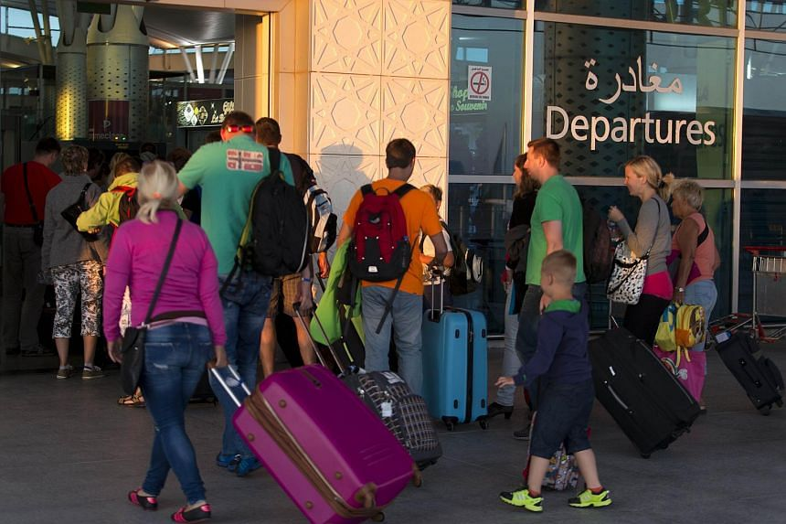 Tourists leave Tunisia at the Enfidha International airport after a shooting attack at the Imperial hotel in the resort town of Sousse.