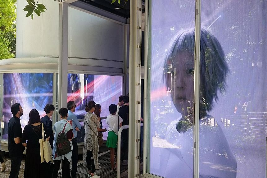 Irina Nakhova plays on fears of Russia's militant might and its chequered history in The Green Pavilion (above), Russia's national pavilion, and The Ways Of Folding Space & Flying by Kyungwon Moon and Joonho Jeon at South Korea's national pavilion (b