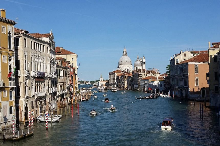 Ride up the Grand Canal through Venice in a vaporetto or water-bus and see dozens of water-facing old buildings turned into temporary art galleries for the 2015 Biennale.