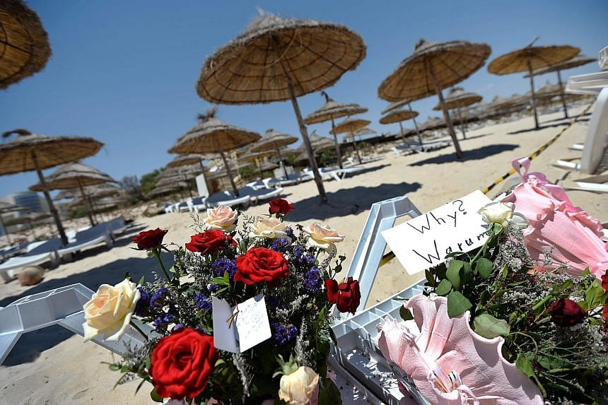 An undated image on Twitter posted yesterday by ISIS' Tunisian branch reportedly showing the gunman who carried out the deadly attack. Flowers and tributes to victims lay on a sun lounger at the Imperial Marhaba resort in Sousse, Tunisia, yesterday,