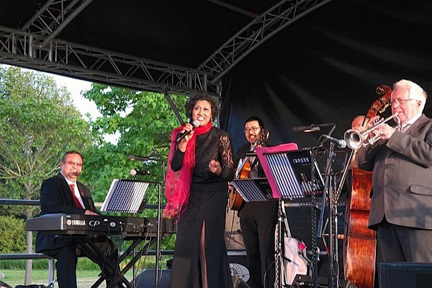 (Far left) A Singapore flag sits atop Broughton Castle in Oxfordshire on Friday. (Left) Cultural Medallion alumnus Jeremy Monteiro (seated) performing with Singaporean singer Rani Singam and the British- Singapore Friendship Jazz Band.