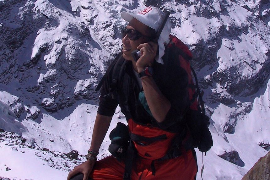 Veteran climber David Lim, seen here using a satellite phone in the Hinku Valley in Nepal, says risks can be controlled only so far.