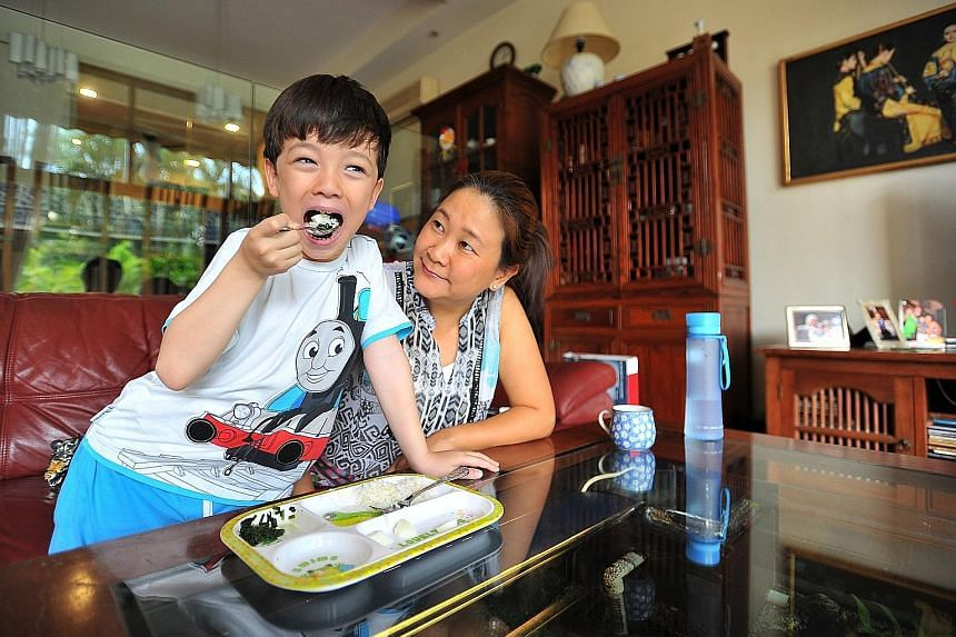 Ms Serene Lim gets her son Sebastien Geniaux (both left) to eat more varieties of food after sending him to a team of specialists, while Ms Sharifah Nurshida Syed Yahya took her daughter Ariana (both above) to a paediatrician. Ms Pauline Xie (below)